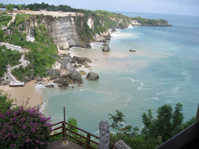 bali indonisia coastline and cliffs with blue sea and beach