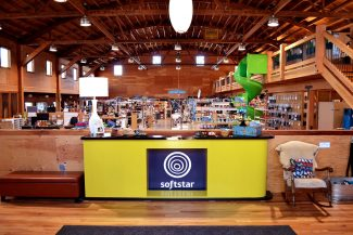 Softstar's renovated workshop is complete with radiant heat flooring, energy efficient lighting, and upcycled building materials.