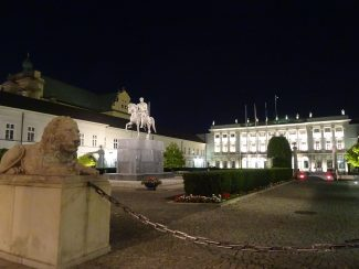 historical buildings of warsaw by night