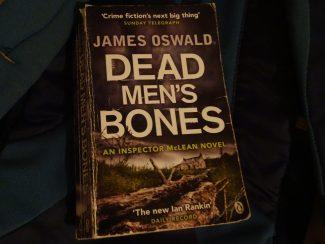 dead mens bones paperback book by james oswald
