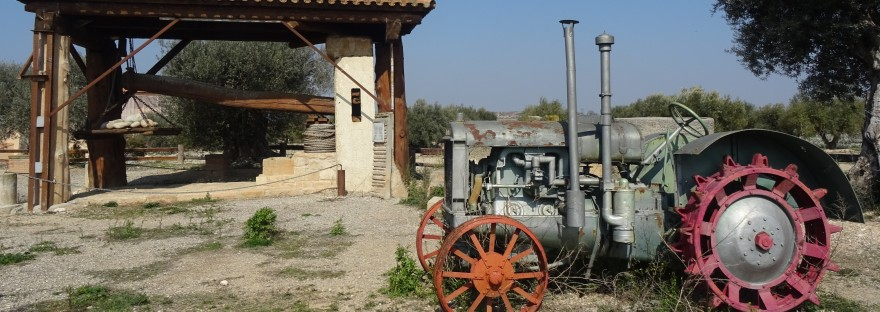 press and tractor outside the parc tematic de l'oli of les garrigues