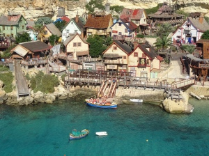 guests to popeye village in malt can enjoy a boat ride in the bay