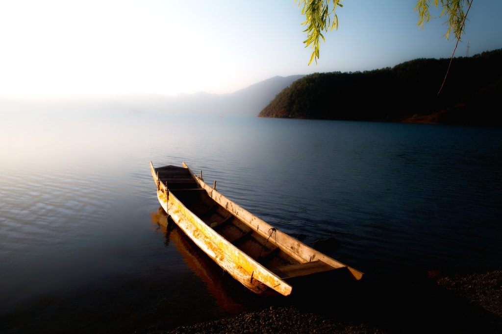 boat o a lake in yunnan, china